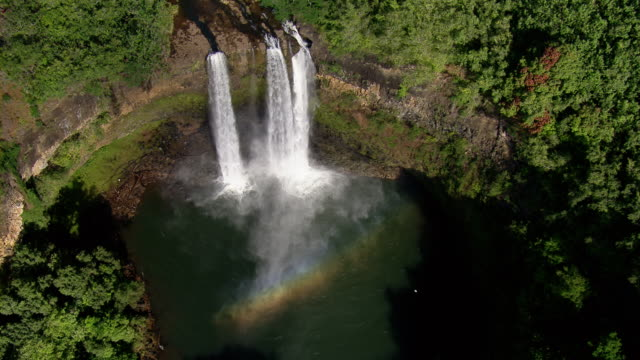 stockvideo's en b-roll-footage met aerial view above wailua waterfall and rainbow on the hawaiian island of kauai. - hawaii islands