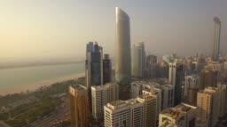 Aerial view. Abu Dhabi cityscape and Corniche Beach. 4K