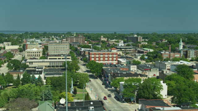 aerial view across downtown fond du lac towards lake winnebago - street name sign stock videos & royalty-free footage