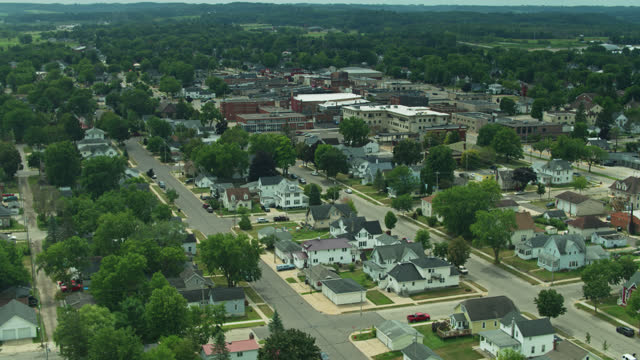 aerial view across houses towards main street of tomah, wisconsin - street name sign stock videos & royalty-free footage
