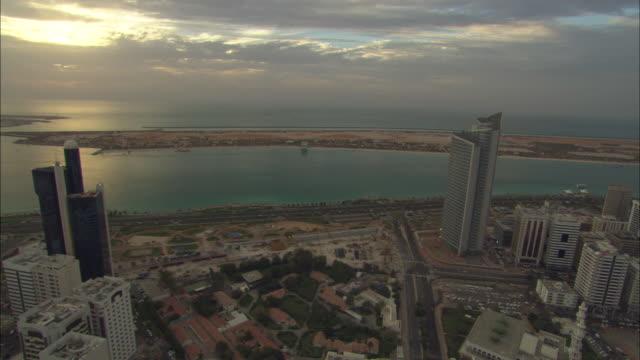 Aerial view Ahbu Dabi, city and waterfront, sun setting, Abu Dhabi, United Arab Emirates