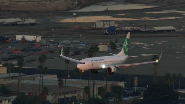 aerial view aircraft over urban neighborhood los angeles - aerospace stock videos & royalty-free footage