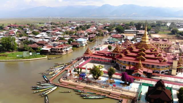 aerial view alodaw pauk pagoda in inle lake, myanmar - myanmar video stock e b–roll