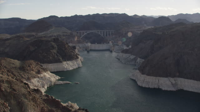 aerial view along colorado river towards hoover dam - river colorado stock videos & royalty-free footage