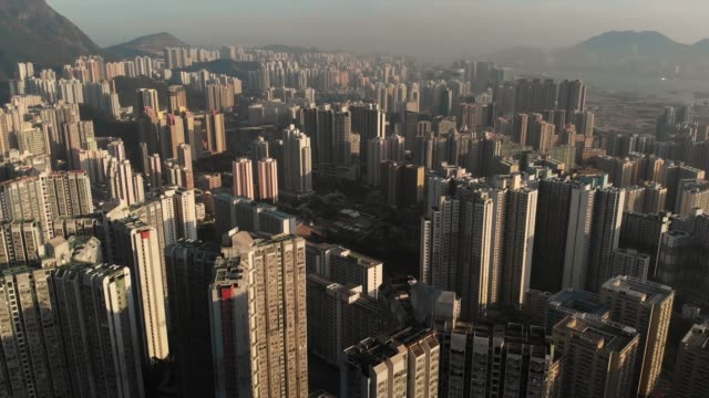 Aerial view and dolly forward of Hong kong skyscraper in sunset time.