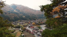 Aerial view and dolly forward of Shirakawago village in autumn season, Gifu, Japan.