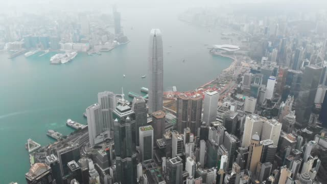 aerial view and dolly left of skyscraper in hong kong. - wanchai stock videos and b-roll footage