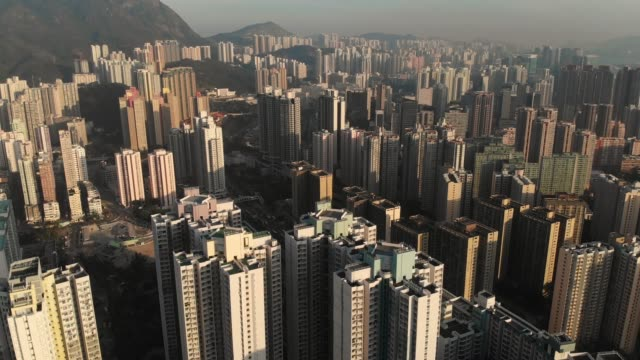 aerial view and tilt up of hong kong skyscraper in sunset time. - tilt stock videos and b-roll footage