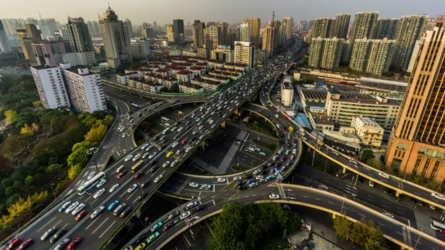 Aerial view and timelapse of highway and traffic in Shanghai, China