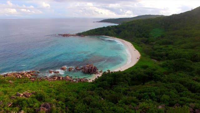 aerial view: anse cocos, la digue island, seychelles - igneous stock videos & royalty-free footage