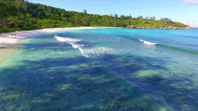 aerial view: anse cocos, la digue island, seychelles - seychelles stock videos & royalty-free footage