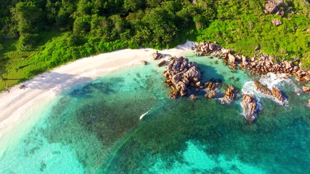 aerial view: anse cocos, la digue island, seychelles - seychelles stock videos & royalty-free footage