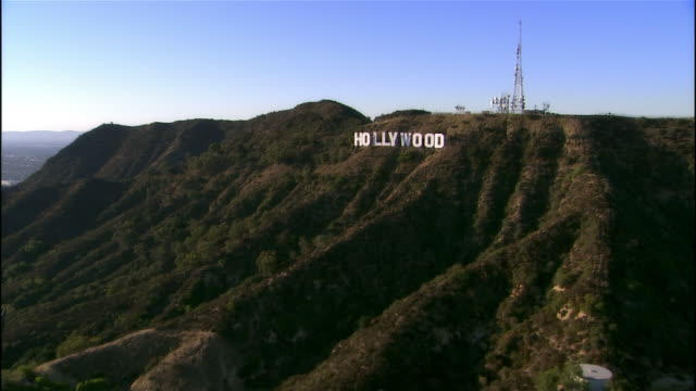 Aerial view approaching and passing over Hollywood Sign / Los Angeles, California