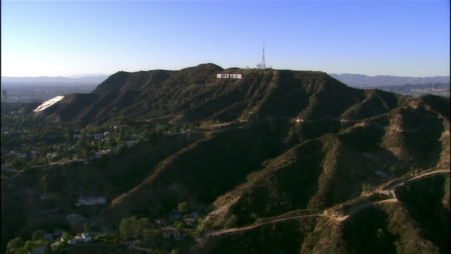 Aerial view approaching Hollywood Sign / Los Angeles, California