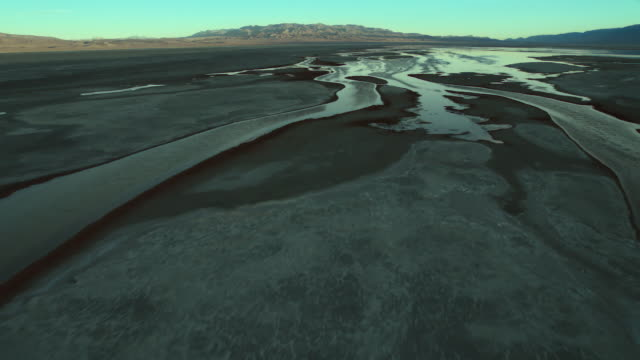 aerial view, approaching one of the sparse wet areas of owens lake, california. - basin and range province stock videos and b-roll footage
