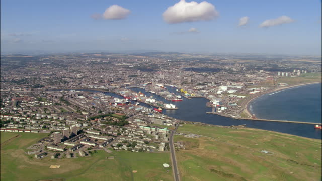 aerial view approaching the city of aberdeen and the harbor / aberdeen, scotland - aberdeen scotland stock videos & royalty-free footage