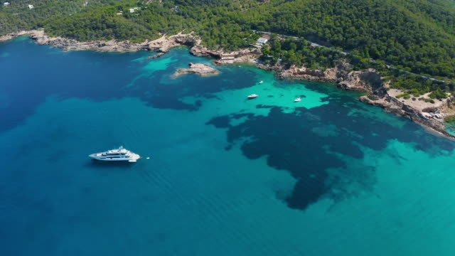 aerial view around scenic balearic islands. ibiza - bay of water stock videos & royalty-free footage