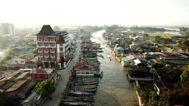 aerial view  asian floating village houses lake in myanmar, burma of inle lake south east asia,floating gardens on inle lake, myanmar (burma) - myanmar stock videos and b-roll footage