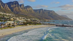 Aerial view at beach in Camps Bay with Twelve Apostles mountain in the background, Cape Town, South Africa