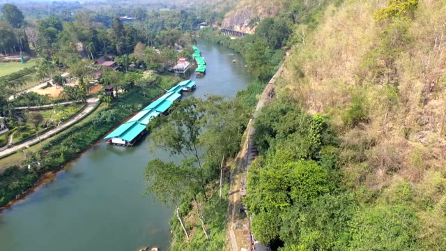 aerial view at beautiful landscape death railway bridge over the kwai noi river at krasae cave in kanchanaburi province thailand - myanmar stock videos and b-roll footage