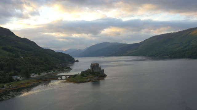 aerial view at dusk eilean donan castle dornie - dornie stock videos & royalty-free footage