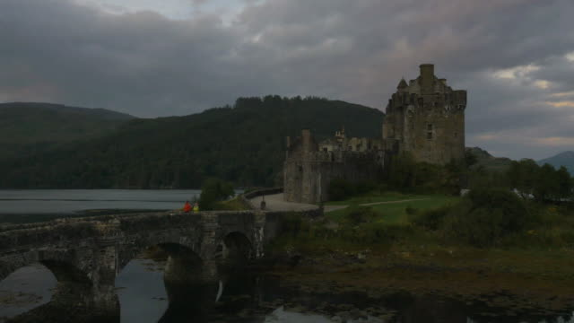 aerial view at dusk eilean donan castle scotland - dornie stock videos & royalty-free footage