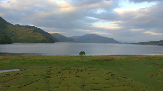aerial view at dusk loch duich dornie scotland - scotland stock videos & royalty-free footage