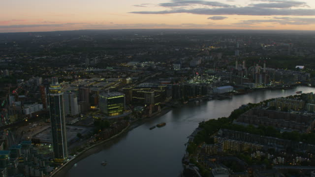 aerial view at dusk river thames london cityscape - battersea stock videos & royalty-free footage
