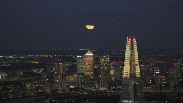 aerial view at night canary wharf skyline london - skyline stock videos & royalty-free footage