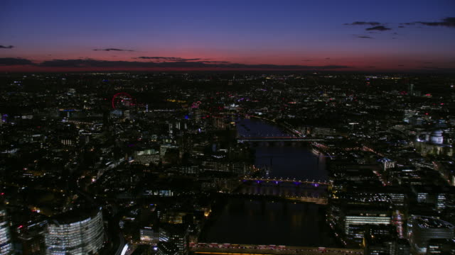 aerial view at night london city lights england - skyline stock videos & royalty-free footage