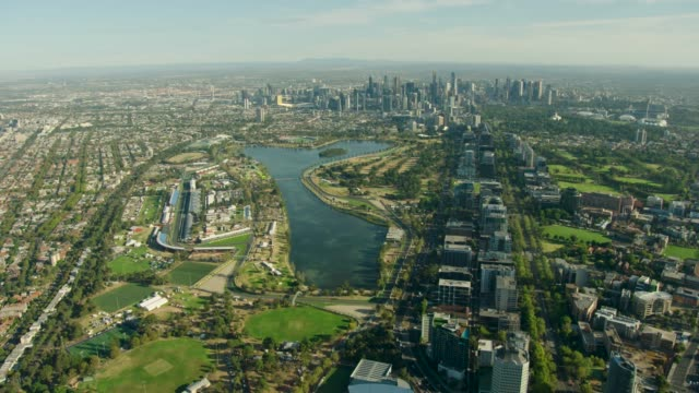 aerial view at sunrise albert park lake melbourne - cityscape stock videos & royalty-free footage