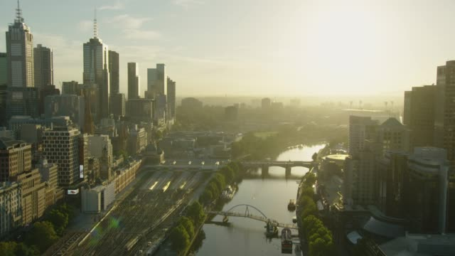 aerial view at sunrise along yarra river melbourne - economy stock videos & royalty-free footage