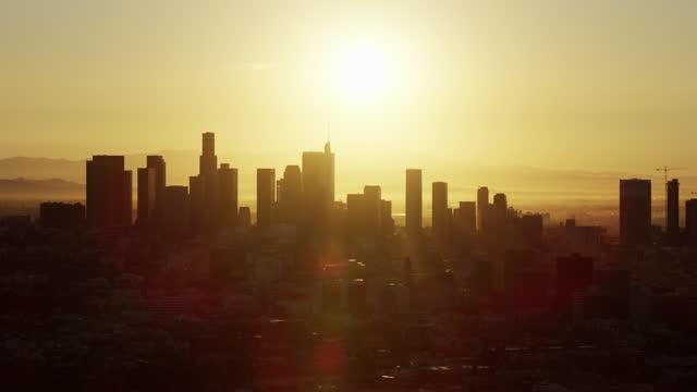 aerial view at sunrise commercial skyscrapers downtown la - us bank tower bildbanksvideor och videomaterial från bakom kulisserna