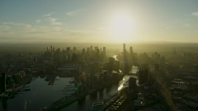 aerial view at sunrise docklands yarra river melbourne - sunrise dawn stock videos & royalty-free footage
