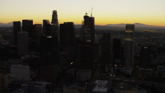 aerial view at sunrise of los angeles cityscape - financial building stock videos & royalty-free footage