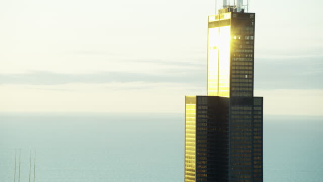 aerial view at sunrise of willis tower chicago - willis tower stock videos and b-roll footage