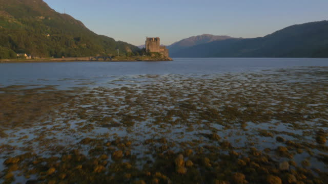 aerial view at sunset eilean donan castle dornie - dornie stock videos & royalty-free footage