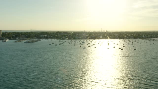 aerial view at sunset hobsons bay williamstown melbourne - anchored stock videos & royalty-free footage