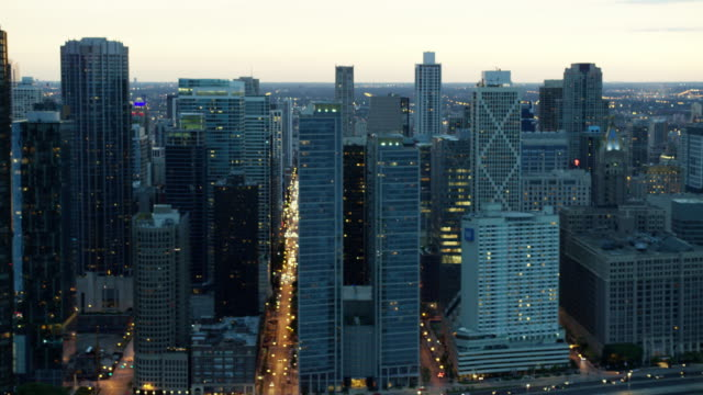 aerial view at sunset of chicago skyscrapers - lakeshore stock videos and b-roll footage