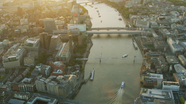 aerial view at sunset river thames transport london - london millennium footbridge stock videos and b-roll footage