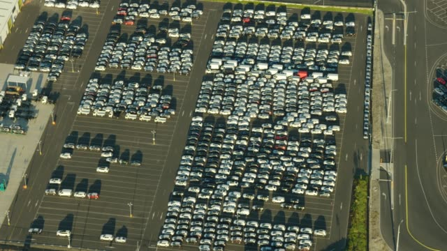 aerial view at sunset vehicles parked port melbourne - car park stock videos & royalty-free footage