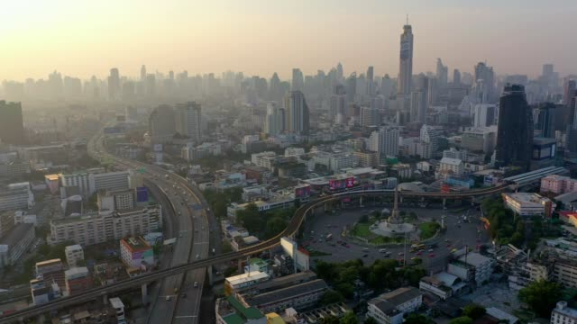 aerial view at victory monument in central of bangkok, thailand on sunrise - passenger train stock videos & royalty-free footage