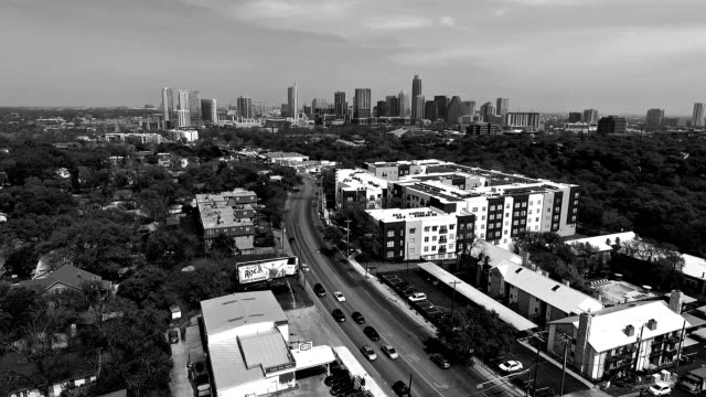 aerial view austin texas 2016 intersection and condominiums on south lamar blvd with skyline cityscape background black and white - austin white stock videos & royalty-free footage