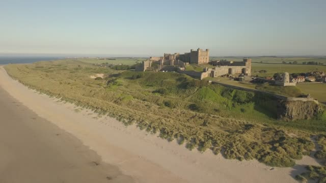 vidéos et rushes de aerial view bamburgh castle from beach, northumberland, england, united kingdom, europe - nord est de l'angleterre