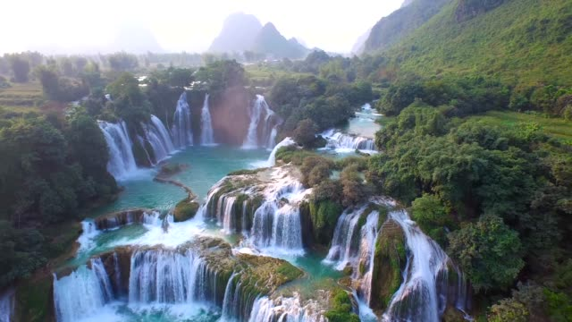 aerial view bangioc waterfall in cao bang province, vietnam - famous place stock videos & royalty-free footage