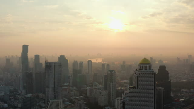 aerial view bangkok city at sunrise - high street stock videos & royalty-free footage