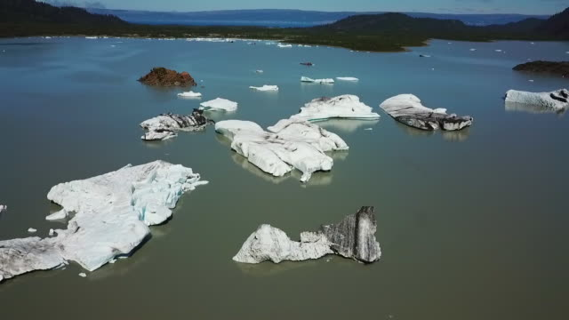 Aerial View Bay with Small Islands and Icebergs