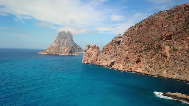 aerial view blue ocean and rocky islands - イビサ島点の映像素材/bロール