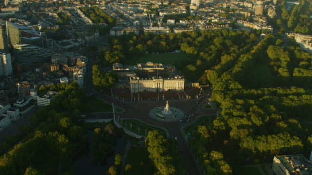 aerial view buckingham palace at sunrise london england - royalty stock videos & royalty-free footage
