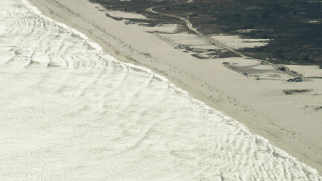 aerial view bulldozer moving sand for defenses florida - subtropical climate stock videos and b-roll footage